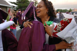 Laquetta Smith, right, gives a congratulatory hug to Lauryn Scott, after the Kalamazoo Central High School graduation ceremony Wednesday, June 7, 2006, at Wings Stadium In Kalamazoo, Mich. Kalamazoo Central was the first graduating class to qualify f