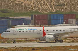 An aircraft belonging to Daallo Airlines is parked at the Aden Abdulle international airport after making an emergency landing following an explosion inside the plane in Somalia's capital Mogadishu, Feb. 3, 2016.