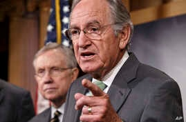 Senator Tom Harkin, sponsor of the Minimum Wage Fairness Act (R), joined by Senate Majority Leader Harry Reid, comments to reporters after the bill to raise the minimum wage to $10.10 was stopped in the Senate, during a news conference on Capitol Hil