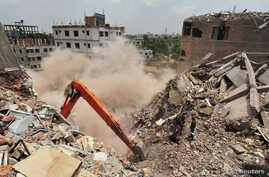 The remaining standing part of the collapsed Rana Plaza building collapses during a rescue operation by the army in Savar, Bangladesh, May 2, 2013.