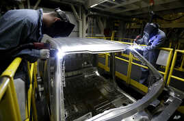 FILE - Workers weld body panels on Ford pickup trucks at the company's Kansas City Assembly Plant in Claycomo, Mo. U.S. worker productivity increased at a 3.1 percent rate in the third quarter, the Labor Department reported Thursday.