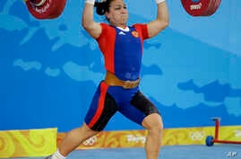 Nadezhda Evstyukhina, of Russia, lifts 138 kilograms in the clean and jerk of the women's 75 kg of the weightlifting competition at the Beijing 2008 Olympics in Beijing, Aug. 15, 2008. Evstyukhina took the bronze medal, which she was stripped of on T