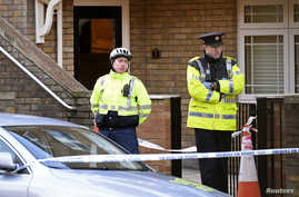 Police officers attend the scene of a shooting at Poplar Row in Dublin, Ireland, Feb. 9, 2016.
