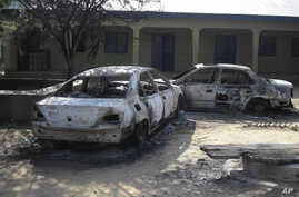 Burnt our cars are seen at the business and skills center following attacks by the Boko Haram sect in Potiskum, Nigeria, October 20, 2012.
