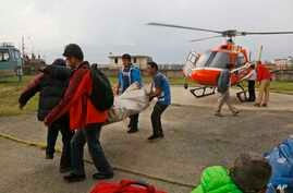 The body of a Macedonian 63-year-old Gjeorgi Petkov is unloaded from a helicopter at Teaching Hospital in Kathmandu, Nepal, May 21, 2018.