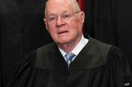 FILE - upreme Court Associate Justice Anthony M. Kennedy joins other justices of the U.S. Supreme Court for an official group portrait at the Supreme Court Building in Washington.