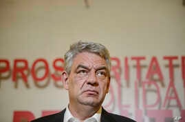 Romanian Prime Minister Mihai Tudose, speaks during a press conference, following a six-hour meeting of the ruling Social Democratic Party in Bucharest, Oct. 12, 2017.