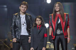 "In this Oct. 8, 2011 file photo, from left, Prince Jackson, Prince Michael II ""Blanket""Jackson and Paris Jackson arrive on stage at the Michael Forever the Tribute Concert, at the Millennium Stadium in Cardiff, Wales."
