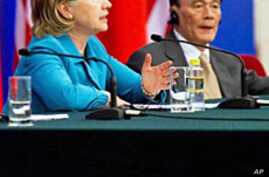 US Secretary of State Hillary Clinton speaks alongside Chinese Vice-Premier Wang Qishan (R) during a signing ceremony in Beijing, 25 May 2010