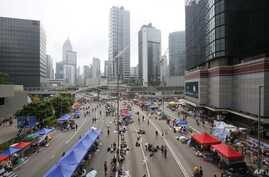 An aerial view shows a thinned crowd of pro-democracy student protesters continuing to occupy the streets around the government complex in Hong Kong, Thursday, Oct. 2, 2014.