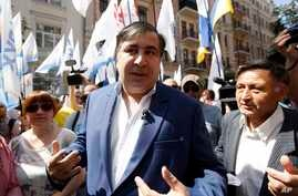 Former Georgian president and former governor of the Ukrainian Odessa region Mikhail Saakashvili surrounded by his supporters at a rally near the Justice Ministry in Kyiv, Ukraine, May 30, 2017.