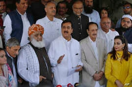 Former Prime Minister Yousuf Raza Gilani (Front-C) a leader in the Pakistan People's Party, and other Pakistani politicians speak to journalists after their meeting in Islamabad, Pakistan, July 30, 2018.
