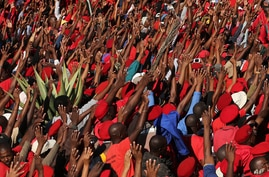 Economic Freedom Fighters' (EFF) supporters sing as they raise their hands during their protest outside the South African Broadcasting Corporation (SABC) building in Johannesburg, South Africa, April 29, 2014.