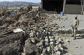 A Pakistani soldier stands on the premises of a destroyed Taliban militant training centre in Sararogha town, which was stronghold of Taliban militants in troubled South Waziristan, on November 17, 2009