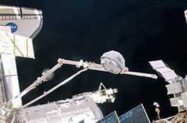 In the grasp of Canadarm2, the cupola is relocated from the forward port to the Earth-facing port of the International Space Station's newly-installed Tranquility node, 15 Feb 2010