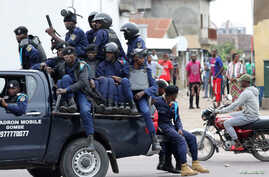 FILE-Police sit in a pickup vehicle in front of Notre Dame Cathedral in Kinshasa, Democratic Republic of Congo, Feb. 25, 2018.