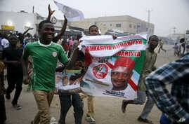 People celebrate after All Progressive Congress (APC) candidate Muhammadu Buhari is pronounced the winner of Nigeria's presidential election, in Kano, March 31, 2015.