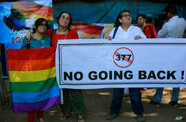 A group of Indian activists hold a banner against section 377 of the Indian Penal Code that criminalizes homosexuality during a protest in Mumbai, India, Dec. 11, 2013.