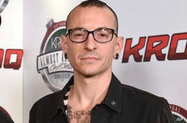 FILE - Chester Bennington poses at the 25th annual KROQ Almost Acoustic Christmas in Inglewood, Calif., Dec. 13, 2014. The Los Angeles County coroner says Bennington has died in his home near Los Angeles. He was 41.