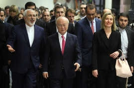 Iranian Foreign Minister Mohammad Javad Zarif, left, Director General of the International Atomic Energy Agency, IAEA, Yukiya Amano of Japan and European Union High Representative Federica Mogherini, right, arrive at the International Atomic Energy A