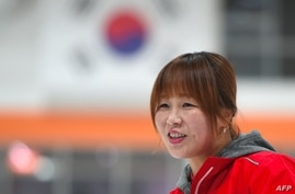 Former North Korean ice hockey player Hwangbo Young coaches an ice hockey class for children at an ice rink in Seoul, South Korea, April, 4, 2017.