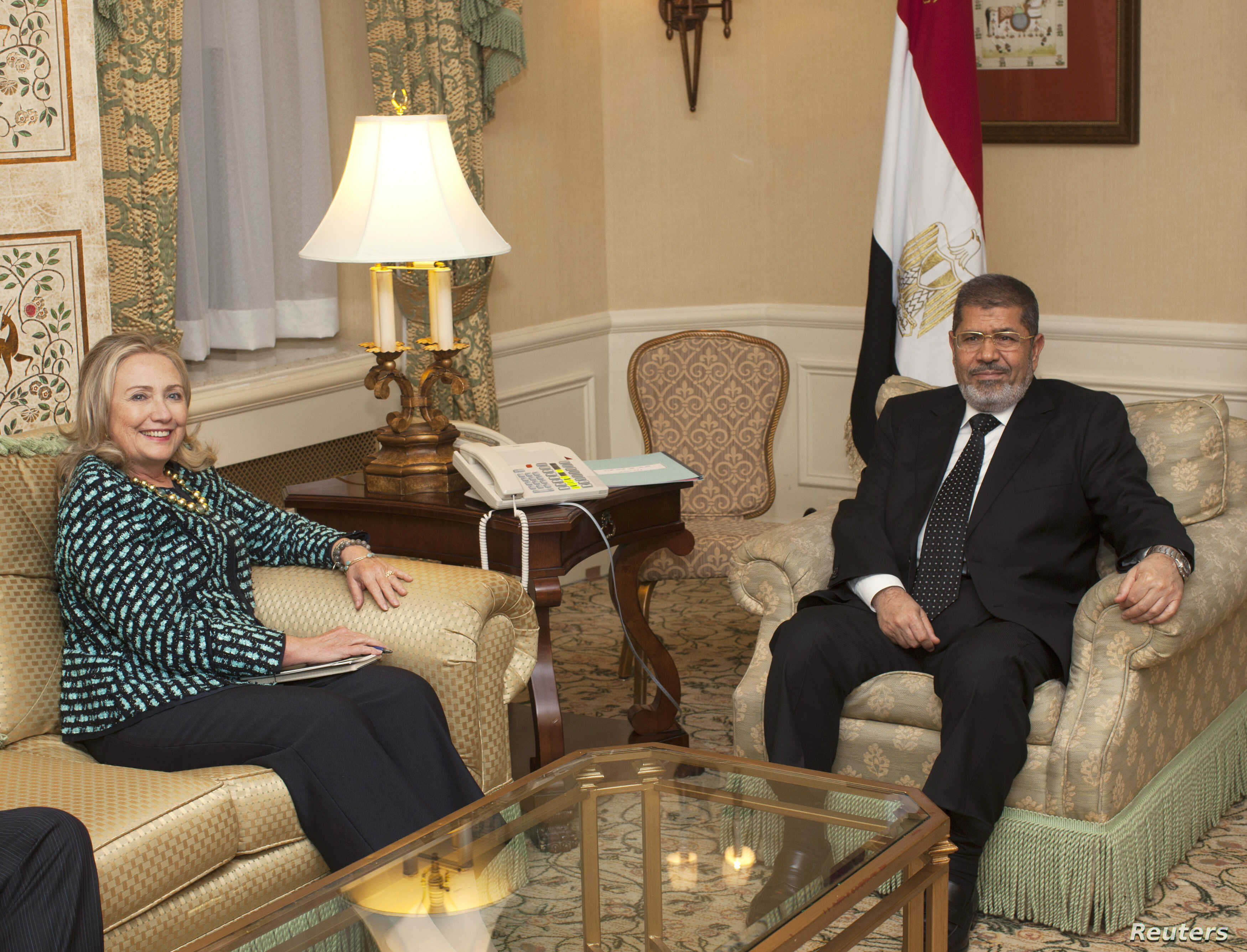 U.S. Secretary of State Hillary Clinton meets with Egyptian President Mohamed Morsi on the sidelines of the United Nations General Assembly in New York, Sept. 24, 2012.