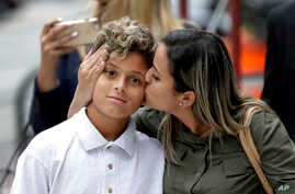 Sirley Silveira Paixao, an immigrant from Brazil seeking asylum, kisses her 10-year-old son Diego Magalhaes after he was released from immigration detention in Chicago, July 5, 2018. A U.S. Justice Department filing made hours before a hearing on Jul...