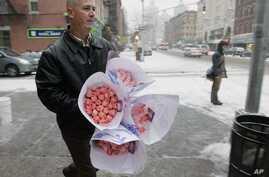 File -- John Wickersham bunches of roses he bought on New York's Upper West Side on Valentine's Day.