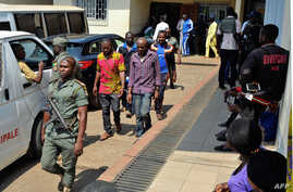 Men arrested in connection with Cameroon's anglophone crisis are seen at the military court in Yaounde, Cameroon, Dec. 14, 2018.