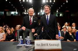 Supreme Court nominee Brett Kavanaugh, standing with Senate Judiciary Chairman Chuck Grassley, R-Iowa,  arrives at the Senate Judiciary Committee on Capitol Hill, Sept. 4, 2018, in Washington, to begin his confirmation hearing to replace retired Just