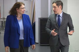 VOA's Carol Pearson (L) speaks with CDC Director Dr. Tom Frieden.
