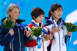 Gold medalist China's Li Jianrou (C), silver medalist Italy's Arianna Fontana (L) and bronze medalist South Korea's Park Seung-hi celebrate during the medal ceremony for the women's 500 meters short track speed skating event at the 2014 Sochi Winter
