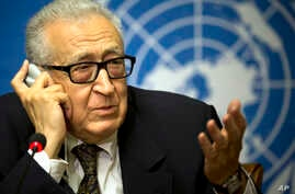 U.N. mediator Lakhdar Brahimi, left, gestures during a press briefing at the United Nations headquarters in Geneva, Feb 11, 2014.