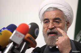Iranian presidential candidate Hasan Rowhani, Iran's former top nuclear negotiator, speaks during a campaign rally in Tehran, May 30, 2013.