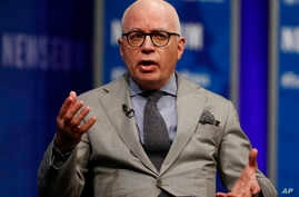 """FILE - Author Michael Wolff is pictured at the Newseum in Washington, April 12, 2017, as he moderates a conversation with presidential counselor Kellyanne Conway during a forum titled """"The President and the Press: The First Amendment in the First 100"""