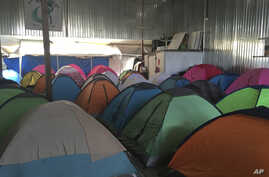 """Temporary tents for about 130 Central Americans, mostly women and children, who arrived at the U.S. border with Mexico in a """"caravan"""" of asylum-seeking immigrants that has drawn the fury of President Donald Trump, are seen in a shelter in Tijuana, Me"""