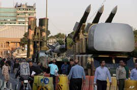 A Russian-made S-300 air defense system, left, is on display for the annual Defense Week, marking the 37th anniversary of the 1980s Iran-Iraq war, at Baharestan Sq. in Tehran, Iran, Sunday, Sept. 24, 2017.