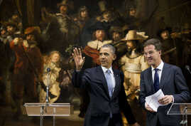 "U.S. President Barack Obama and Prime Minister of the Netherlands Mark Rutte leave after their joint statement in front of Rembrandt's ""The Nightwatch"" at Rijksmuseum in Amsterdam, Netherlands, March 24, 2014."