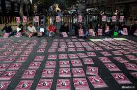Activists hold a protest against a law that militarises crime fighting in the country outside the Senate in Mexico City, Mexico Dec. 5, 2017.