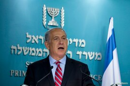 Israeli Prime Minister Benjamin Netanyahu delivers a statement at his office in Jerusalem Nov. 24, 2013.