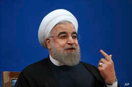 Iranian President Hassan Rouhani gestures as he speaks in a press conference at the presidency compound in Tehran, Iran, Tuesday, Jan. 17, 2017.