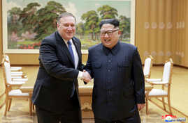 North Korean leader Kim Jong Un shakes hands with U.S. Secretary of State Mike Pompeo, May 9, 2018, released by North Korea's Korean Central News Agency (KCNA) in Pyongyang.