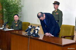 One of the two men whom North Korea identified as being South Korean and accused of being a spy for South Korea bows during a news conference in Pyongyang, in this undated photo released by North Korea's Korean Central News Agency (KCNA) in Pyongyang