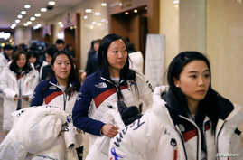 South Korean women's ice hockey team members leave after attending an inaugural ceremony ahead of the 2018 Pyeongchang Winter Olympics, in Seoul, South Korea, Jan. 24, 2018.