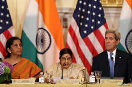U.S. Secretary of State John Kerry (R) listens to India's Minister of Commerce and Industry Nirmala Sitharaman (L) and External Affairs Minister Sushma Swaraj (C) at the U.S-India Strategic & Commercial Dialogue plenary session at the State Departmen...