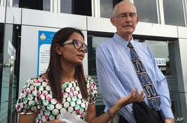 Alan Morison, right, Australian editor of the website Phuketwan and his colleague Chutima Sidasathien speak to the media ahead of their appearance in court to face charges of violating Thailand's Computer Crime Act in Phuket, Thailand, July 14, 2015.