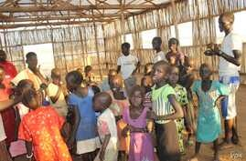 Children gather in a makeshift church in the U.N. House camp for displaced persons in Juba, South Sudan, to rehearse for the Christmas choir performance.