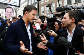Dutch Prime Minister Mark Rutte of the VVD Liberal party speaks to the media as he campaigns for the 2017 Dutch election in Breda, Netherlands, March 11, 2017.