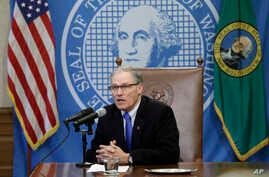 Washington Gov. Jay Inslee speaks after signing a bill, March 5, 2018, in Olympia, Washington, that makes Washington the first state to set up its own net-neutrality requirements in response to the FCC's recent repeal of Obama-era rules.