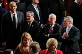 From left to right: Sen. Cory Booker, D-N.J., Sen. Robert Menendez, D-N.J., Sen. Ben Cardin, D-Md., and Sen. Richard Durbin, D-Ill., wait for the arrival of President Donald Trump to deliver his State of the Union address to a joint session of Congre